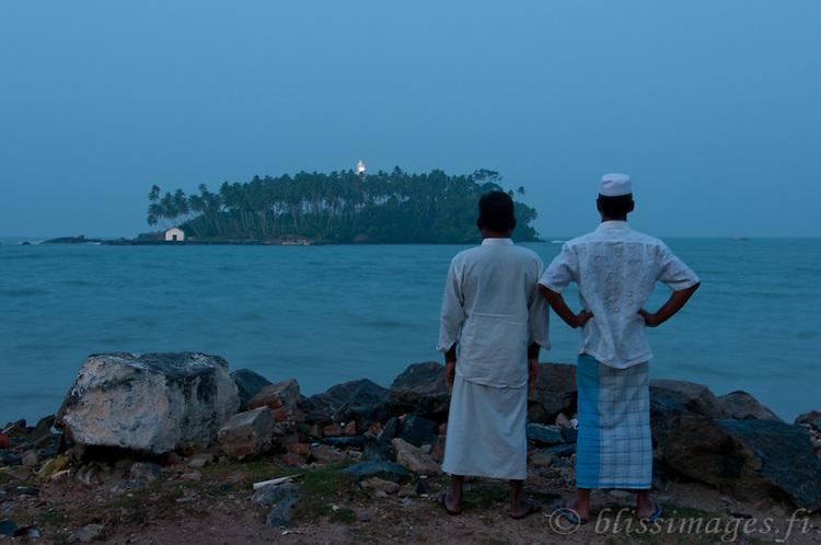 Tamil (Muslim) villagers look out to Barberyn (Beruwala) light at twilight -Beruwala, Sri Lanka