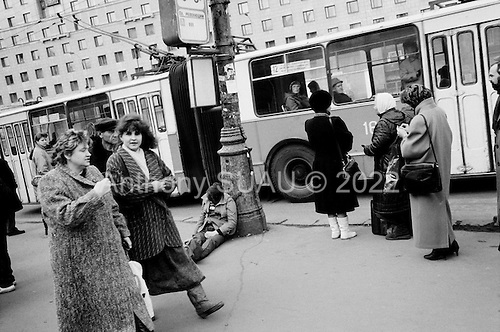 """Moscow, Russia<br /> October 22, 1992<br /> <br /> Leaving the poor and pensioners with little, street drinks appear in number as well as alcohol advertisements, which are some of the first commercials to arrive in Russia. <br /> <br /> In December 1991, food shortages in central Russia had prompted food rationing in the Moscow area for the first time since World War II. Amid steady collapse, Soviet President Gorbachev and his government continued to oppose rapid market reforms like Yavlinsky's """"500 Days"""" program. To break Gorbachev's opposition, Yeltsin decided to disband the USSR in accordance with the Treaty of the Union of 1922 and thereby remove Gorbachev and the Soviet government from power. The step was also enthusiastically supported by the governments of Ukraine and Belarus, which were parties of the Treaty of 1922 along with Russia.<br /> <br /> On December 21, 1991, representatives of all member republics except Georgia signed the Alma-Ata Protocol, in which they confirmed the dissolution of the Union. That same day, all former-Soviet republics agreed to join the CIS, with the exception of the three Baltic States."""