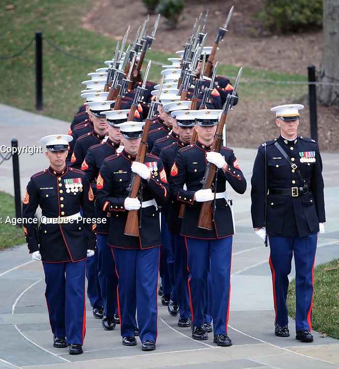 With full Ceremonial Honors presented, members of the Marine Corps Honor Guard march into place at the Tomb of the Unknowns prior to the arrival of The Right Honorable Justin Trudeau, Prime Minister of Canada. The Prime Minister was at Arlington National Cemetery to lay a wreath at the Tomb of the Unknowns in honor of the Prime Minister's official visit to the United States. (Department of Defense photo by Marvin Lynchard)