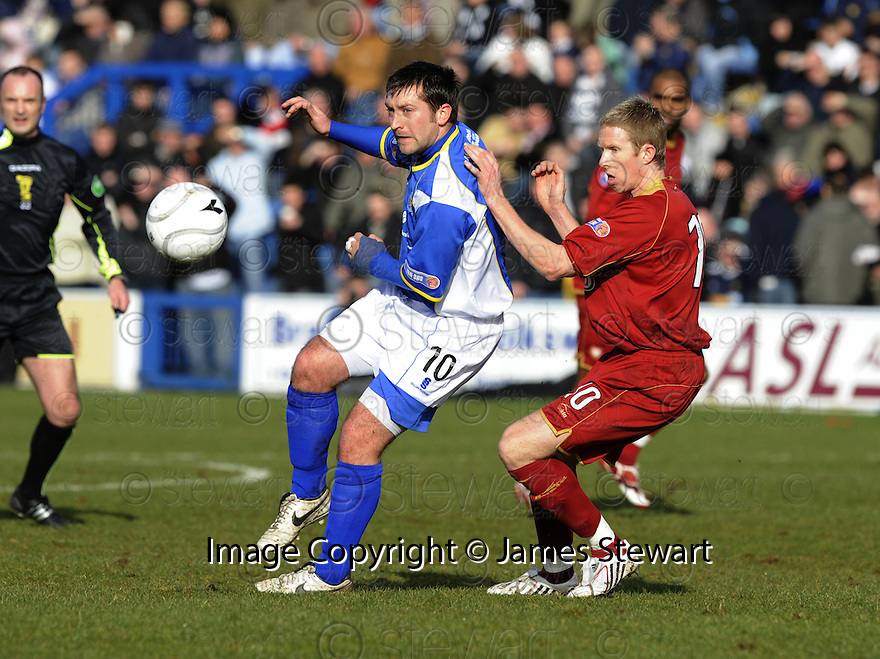 08/03/2008    Copyright Pic: James Stewart.File Name : sct_jspa02_qots_v_dundee.STEPHEN DOBBIE GETS AWAY FROM DAVID COWAN.James Stewart Photo Agency 19 Carronlea Drive, Falkirk. FK2 8DN      Vat Reg No. 607 6932 25.Studio      : +44 (0)1324 611191 .Mobile      : +44 (0)7721 416997.E-mail  :  jim@jspa.co.uk.If you require further information then contact Jim Stewart on any of the numbers above........