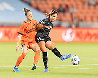 HOUSTON, TX - SEPTEMBER 10: Katie Johnson #33 of the Chicago Red Stars passes the ball to a teammate in front of Gabby Seiler #5 of the Houston Dash during a game between Chicago Red Stars and Houston Dash at BBVA Stadium on September 10, 2021 in Houston, Texas.