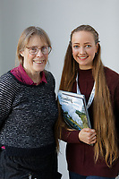 Pictured L-R: Prue Thimbleby who works for the NHS with volunteer Ashleigh Steyn, 20 a biochemistry student. Wednesday 27 November 2019<br /> Re: Christmas appeal story, volunteers read books to some of the elderly patients at Singleton hospital in Swansea, Wales, UK.