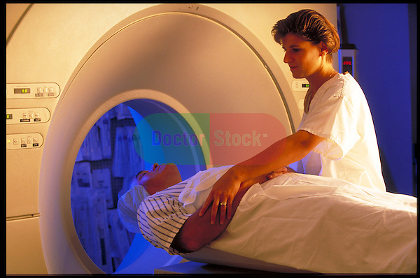 CAT scan technician positioning patient