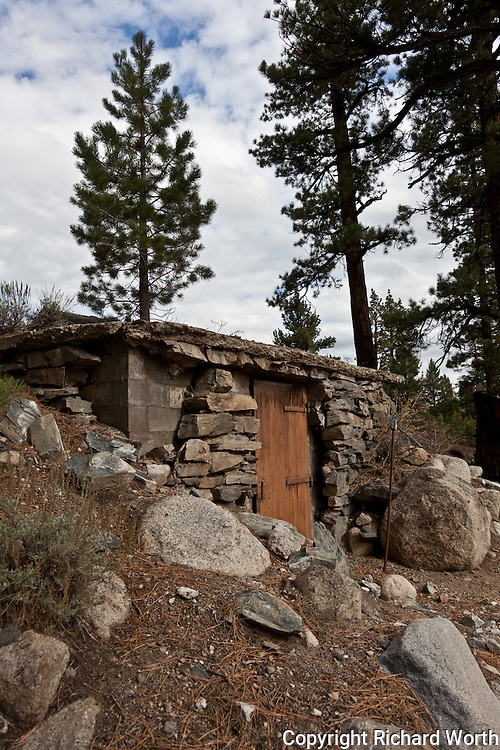 Looking the worse for wear, but still boasting a padlock on it's rusted iron door, a mostly rock-faced, cinder block dugout outbuilding along Sonora Pass road in the Eastern Sierras.