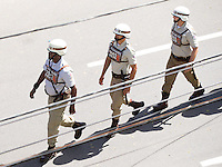 Lines of army officers patrol the streets