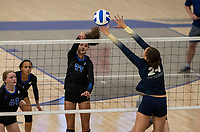 Brooklyn Weaver (27) of Rogers hits ball over the net against Riley Richardson (24) of Bentonville West at Rogers High School, Rogers, AR, on Thursday, September 9, 2021 / Special to NWADG David Beach
