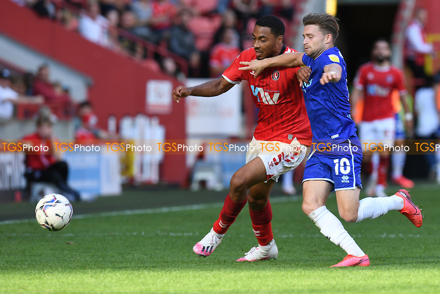 Akin Famewo of Charlton Athletic FC and Alfie May of Cheltenham FC during Charlton Athletic vs Cheltenham Town, Sky Bet EFL League 1 Football at The Valley on 11th September 2021