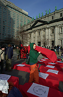 Montreal, April 17, 2001<br /> A group of demonstrators opposed to the Free Trade Area of the Americas (FTAA) leaves with coffins symbolizing the victims of the world globalization<br /> on April 17, 2001 in downtown Montreal (Quebec, CANADA), near the Queen Elizabeth Hotel where the `` Conference of Montreal `` on economy globalization is beeing held until April 19th 2001.<br /> <br /> The  conference feature speakers such as Mexico President Foxx and New York Governor Pataki.<br /> <br /> Photo by Pierre Roussel <br /> NOTE :  Uncorrected D-1 JPEG saved as Adobe RGB color space.