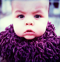 Baby wrapped in purple scarf<br />