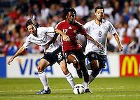 US midfielders Sacha Kljestan (16) and Clint Dempsey (8) collapse around Trinidad & Tobago midfielder Keon Daniel (17).  The U.S. Men's National Team defeated Trinidad & Tobago 3-0 at Toyota Park in Bridgeview, IL on September 10, 2008.