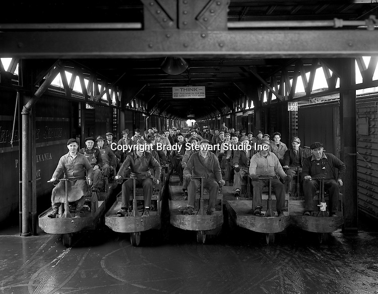 Pittsburgh PA:  Pennsylvania Railroad workers at the 11th street freight station<br /> <br /> Unique driving freight carts used by the Pennsylvania railroad at many train stations.