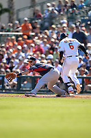 Boston Red Sox first baseman Mike Carp (37) stretches for a throw as Jonathan Schoop (6) runs through the bag during a spring training game against the Baltimore Orioles on March 8, 2014 at Ed Smith Stadium in Sarasota, Florida.  Baltimore defeated Boston 7-3.  (Mike Janes/Four Seam Images)