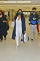 MIAMI, FL - JULY 15: (EXCLUSIVE COVERAGE) Garcelle Beauvais (C) is seen at Miami International Airport with her son and Jax Joseph Nilon on July 15, 2021 in Miami, Florida.  (Photo by Vallery Jean / jlnphotography.com )