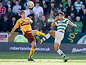:: SAND FLIES EVERYWHERE AS MOTHERWELL'S KEITH LASLEY  AND CELTIC'S EMILIO IZAGUIRRE GO FOR THE BALL ::