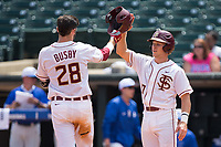 Dylan Busby (28) of the Florida State Seminoles is greeted at home plate by teammate Taylor Walls (10) after hitting a home run against the Duke Blue Devils in the first semifinal of the 2017 ACC Baseball Championship at Louisville Slugger Field on May 27, 2017 in Louisville, Kentucky.  The Seminoles defeated the Blue Devils 5-1.  (Brian Westerholt/Four Seam Images)