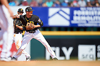 Pittsburgh Pirates shortstop Jordy Mercer (10) throws to first base during a Spring Training game against the Tampa Bay Rays on March 10, 2017 at LECOM Park in Bradenton, Florida.  Pittsburgh defeated New York 4-1.  (Mike Janes/Four Seam Images)