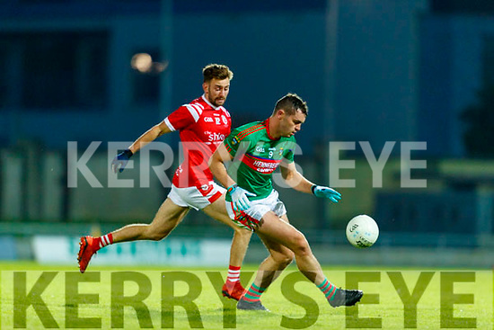 Brendan O'Keeffe, East Kerry  and Ronan Murphy, Mid Kerry during the Kerry County Senior Football Championship Final match between East Kerry and Mid Kerry at Austin Stack Park in Tralee on Saturday night.