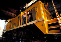 Roundhouse foreman and electrician shown working on diesel locomotive. Houston Texas USA Houston Belt and Terminal.