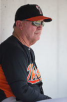 Norfolk Tides manager Ron Johnson (4) watches the action from the dugout during the game against the Charlotte Knights at BB&T BallPark on June 7, 2015 in Charlotte, North Carolina.  The Tides defeated the Knights 4-1.  (Brian Westerholt/Four Seam Images)