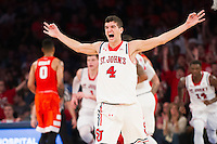 NEW YORK, NY - Sunday December 13, 2015: Federico Mussini (#4) of St. John's celebrates a key basket late in the game.  St. John's defeats Syracuse 84-72 during the NCAA men's basketball regular season at Madison Square Garden in New York City.