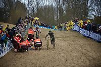 race leaders Sven Nys (BEL/Crelan-AAdrinks) & Wout Van Aert (BEL/Vastgoedservice-Golden Palace) need to deviate around the crashed Michael Vanthourenhout (BEL/Sunweb-Napoleon Games) in the last lap (while fighting for the win)<br /> <br /> Duinencross Koksijde WorldCup 2015