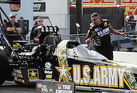 Mar. 10, 2012; Gainesville, FL, USA; Crew chief Mike Green directs NHRA top fuel dragster driver Tony Schumacher during qualifying for the Gatornationals at Auto Plus Raceway at Gainesville. Mandatory Credit: Mark J. Rebilas-