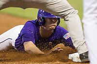 LSU Tigers outfielder Mark Laird #9 slides safely into third base during the Southeastern Conference baseball game against the Georgia Bulldogs on March 22, 2014 at Alex Box Stadium in Baton Rouge, La. The Tigers defeated the Bulldogs 2-1. (Andrew Woolley/Four Seam Images)