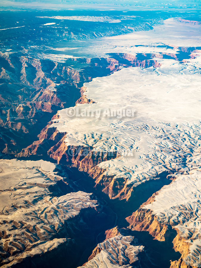 Little Colorado River and the Grand Canyon, snow, from a window seat on a United Airlines flight from Chicago to Los Angeles over America's Flyover County.