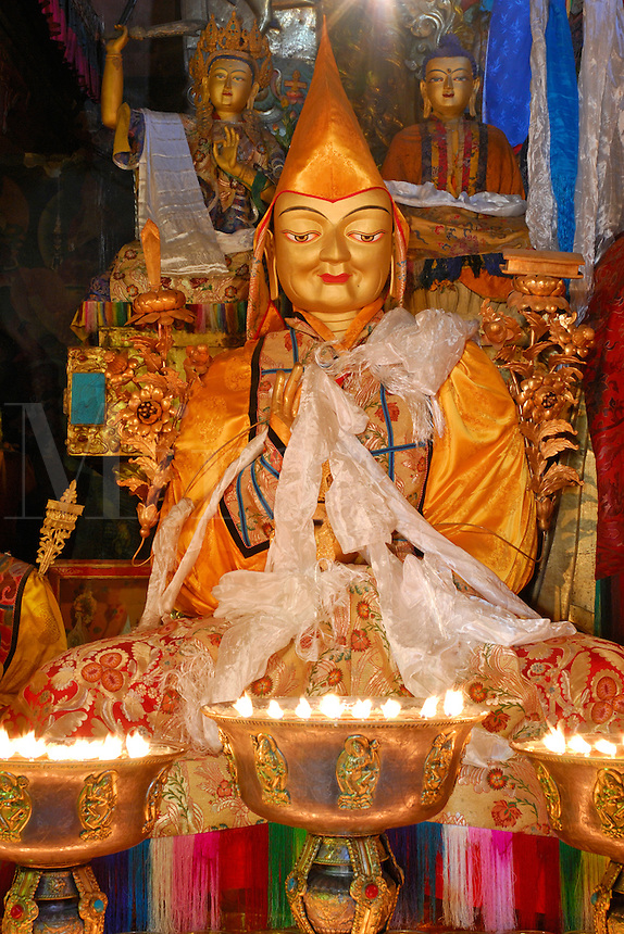 Statue of 13th Dalai Lama flanked behind left by Jampelyang, Bodhisattva of Wisdom, Buddha Sakyamuni on right, in the Main Assembly Hall at Sera Monastery, Lhasa, Tibet, China.