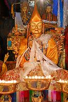 Statue of 13th Dalai Lama flanked behind left by Jampelyang, Bodhisattva of Wisdom, Buddha Sakyamuni on right, in the Main Assembly Hall at Sera Monastery, Lhasa, Tibet, China.
