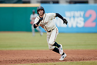 Jared Triolo (19) of the Greensboro Grasshoppers takes off for third base during the game against the Rome Braves at First National Bank Field on May 16, 2021 in Greensboro, North Carolina. (Brian Westerholt/Four Seam Images)