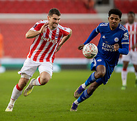 9th January 2021; Bet365 Stadium, Stoke, Staffordshire, England; English FA Cup Football, Carabao Cup, Stoke City versus Leicester City; Sam Vokes of Stoke City and Wesley Fofana of Leicester City chase a loose ball