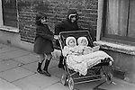 Farthing Bundles. Fern Street Settlement. East London. England 1971, Twins in pram with bundles.