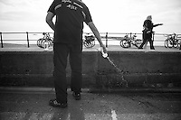 emptying bidons<br /> <br /> 2013 Tour of Britain<br /> stage 6: Sidmouth to Haytor (Dartmorr): 137km