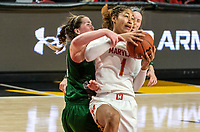 COLLEGE PARK, MD - DECEMBER 8: Stephanie Karcz #10 of Loyola battles for the ball with Shakira Austin #1 of Maryland during a game between Loyola University and University of Maryland at Xfinity Center on December 8, 2019 in College Park, Maryland.