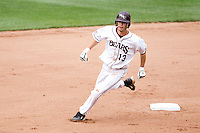 Kevin Medrano (13) of the Missouri State Bears passes up second base on his way to third during a game against the Bradley Braves on May 13, 2011 at Hammons Field in Springfield, Missouri.  Photo By David Welker/Four Seam Images