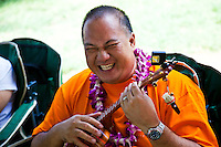 Festival oranizer Jayson Tanega plays his ukulele at the 40th Annual Ukulele Festival at Kapiolani Park