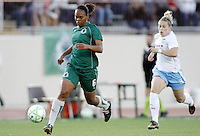 Kia McNeil (green) pursued by Ella Masar..Saint Louis Athletica were defeated 1-0 by Chicago Red Stars.