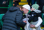 Neil Lennon walks over to apologise to the fan mistakenly involved in last week's aggro