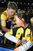 Beauden Barrett signs autographs after the Super Rugby match between the Hurricanes and Chiefs at Westpac Stadium, Wellington, New Zealand on Saturday, 23 April 2016. Photo: Dave Lintott / lintottphoto.co.nz