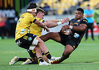 20th March 2021; Wellington, New Zealand;  Chiefs Samisoni Taukei'aho is hit hard by Hurricanes Jordie Barrett. Super Rugby Aotearoa. Hurricanes v Chiefs. Sky Stadium, Wellington. Saturday 20th March 2021.