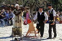 Pictured: Men dressed in costumes during the Bourani celebrations in Tirnavos, central Greece. Monday 11 March 2019<br /> Re: Bourani (or Burani) the infamous annual carnival which dates to 1898 which takes place on the day of (Clean Monday), the first days of Lent in Tirnavos, central Greece, in which men hold phallus shaped objects as scepters in their hands.