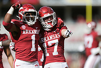 Arkansas defensive back Hudson Clark (17) reacts after intercepting a pass, Saturday, October 17, 2020 during the third quarter of a football game at Donald W. Reynolds Razorback Stadium in Fayetteville. Check out nwaonline.com/201018Daily/ for today's photo gallery. <br /> (NWA Democrat-Gazette/Charlie Kaijo)