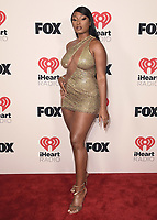 """HOLLYWOOD, CA - MAY 27:  Megan Thee Stallion at the 2021 """"iHeartRadio Music Awards"""" airing live from The Dolby Theatre in Los Angeles, Thursday, May 27 (8:00-10:00 PM ET live / PT tape-delayed) on FOX. CR: Scott Kirkland/FOX/PictureGroup © 2021 FOX MEDIA, LLC. (Photo by Scott Kirkland/FOX/PictureGroup)"""