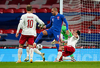 Kasper Dolberg (Nice) of Denmark is brought down in-between Goalkeeper Jordan Pickford (Everton) of England and Kyle Walker (Manchester City) of England for the penalty during the UEFA Nations League match played behind closed doors due to the current government Covid-19 rules within sports venues between England and Denmark at Wembley Stadium, London, England on 14 October 2020. Photo by Andy Rowland.