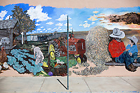 A mural depicts farm and ranch life on a building in downtown Cut Bank, Montana, USA.