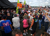 Mar 14, 2015; Gainesville, FL, USA; Fans look on as NHRA top fuel driver Clay Millican warms up his dragster in the pits during qualifying for the Gatornationals at Auto Plus Raceway at Gainesville. Mandatory Credit: Mark J. Rebilas-