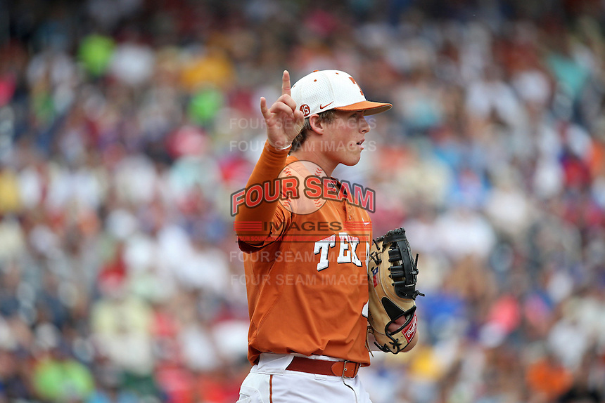 Kacy Clemens #42 of the Texas Longhorns looks on during Game 1 of the 2014 Men's College World Series between the UC Irvine Anteaters and Texas Longhorns at TD Ameritrade Park on June 14, 2014 in Omaha, Nebraska. (Brace Hemmelgarn/Four Seam Images)