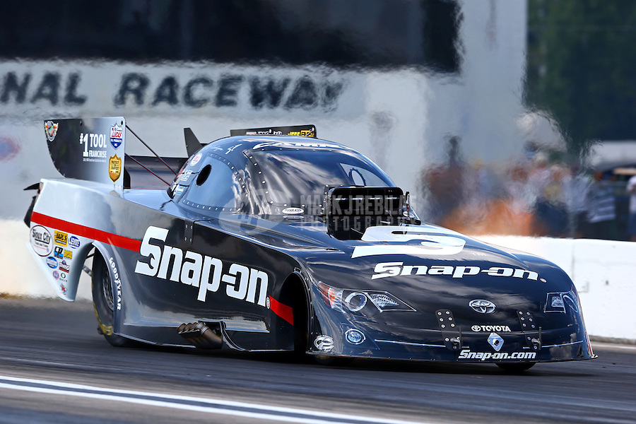 Aug. 16, 2013; Brainerd, MN, USA: NHRA funny car driver Cruz Pedregon during qualifying for the Lucas Oil Nationals at Brainerd International Raceway. Mandatory Credit: Mark J. Rebilas-
