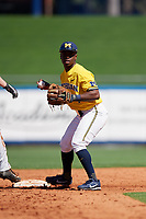 Michigan Wolverines second baseman Ako Thomas (4) checks the runner during a game against Army West Point on February 17, 2018 at Tradition Field in St. Lucie, Florida.  Army defeated Michigan 4-3.  (Mike Janes/Four Seam Images)